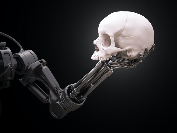 A robotic arm holding a human skull