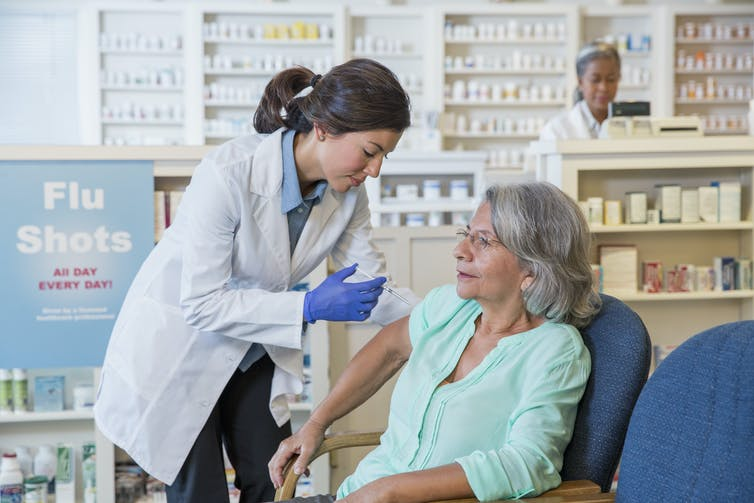 The flu vaccine carries only a dead version of the virus.