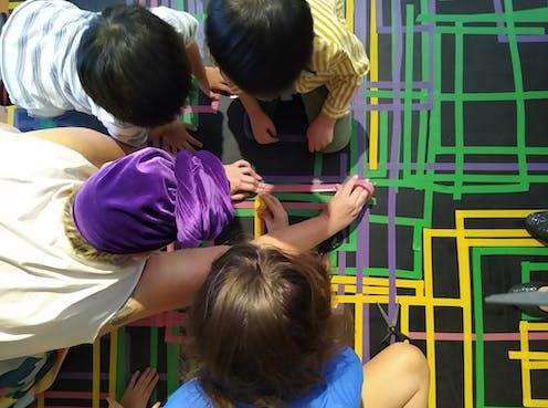 Children make an artwork