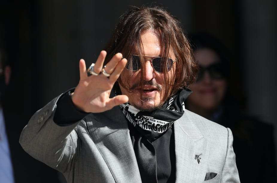 US actor Johnny Depp waves to fans.