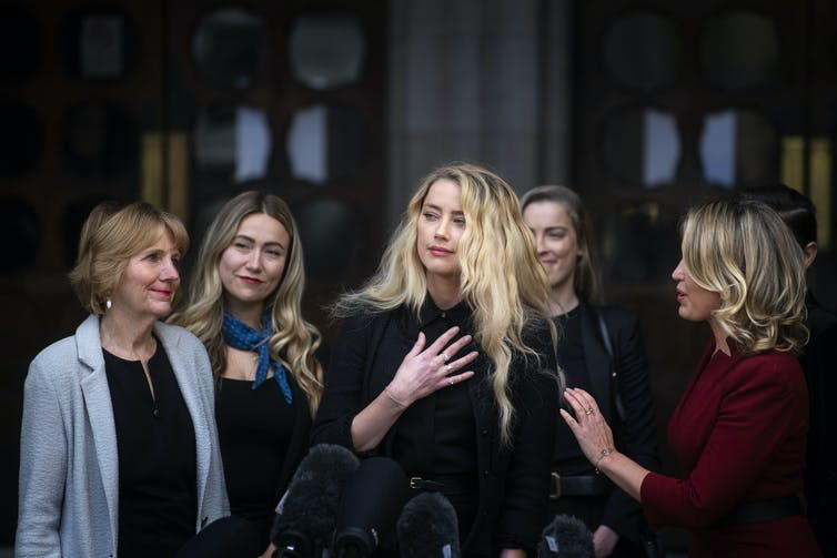 Actress Amber Heard with her sister and lawyer and supporters outside the UK High Court in London, July 2020.