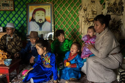 A Mongolian family in traditional dress