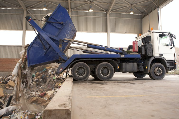 A truck dumping waste to get incinerated