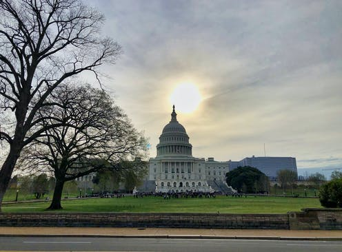 The sun sets over the U.S. Capitol Building.