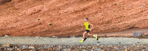 Man running long distance in a desert.
