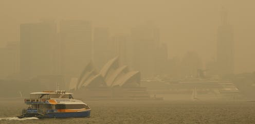 A ferry in Sydney Harbour blanketed in smoke.