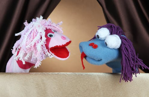 Two puppets talking to each other
