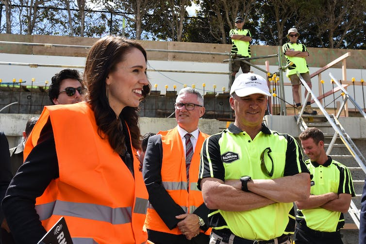 Jacinda Ardern with builders on a site
