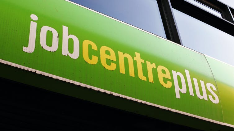 Job Centre Plus sign shot from below.