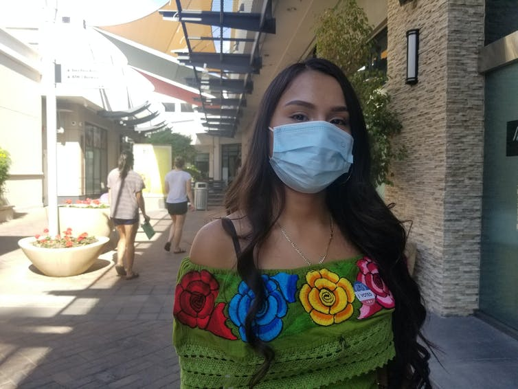 Young woman in Phoenix wearing mask.