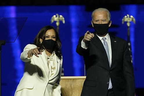 Kamala Harris and Joe Biden point to their crowd of supporters after giving their victory speeches.