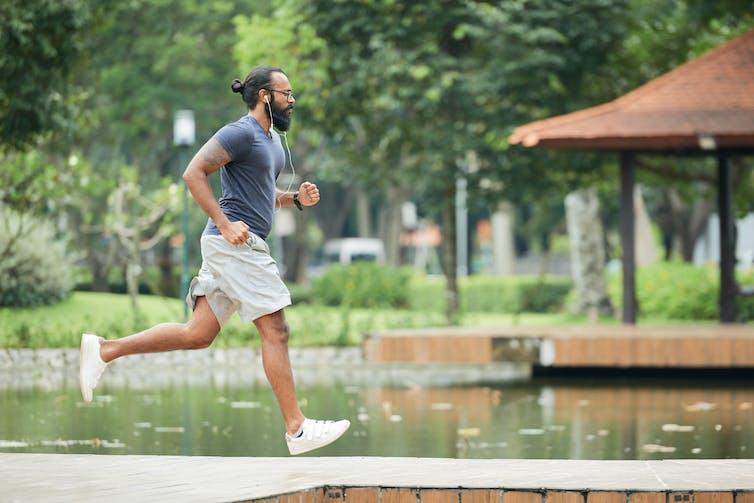 A man runs in a park.