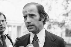 A young Biden is seen talking to the media.