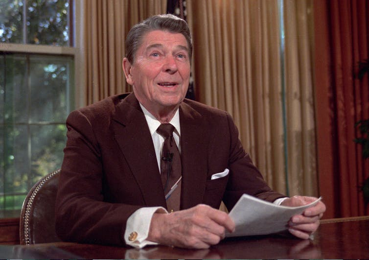 Ronald Reagan in the Oval Office.