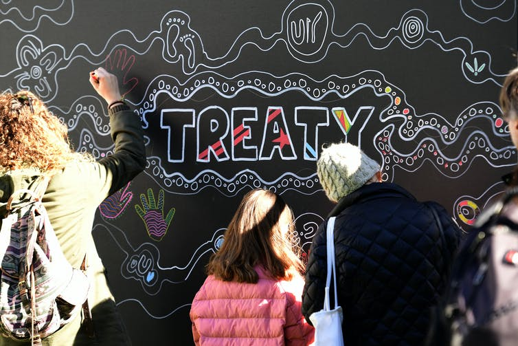 The word 'treaty' appears on a wall.