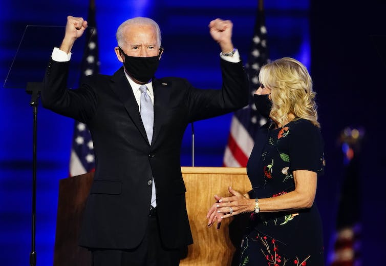 Joe Biden wearing a mask and celebrating becoming the next US president