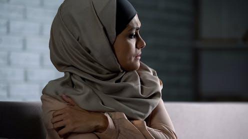 Crying muslim female.