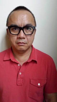 A man in glasses.