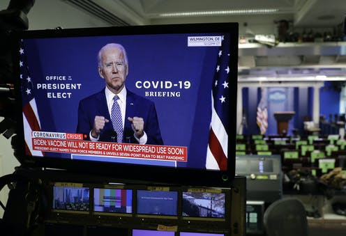 A tv screen in a US newsroom showing president-elect Joe Biden .