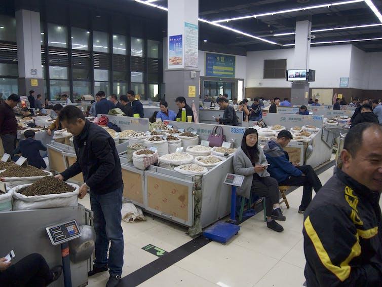 Small trading stalls at Bozhou Traditional Market, Anhui Province, China