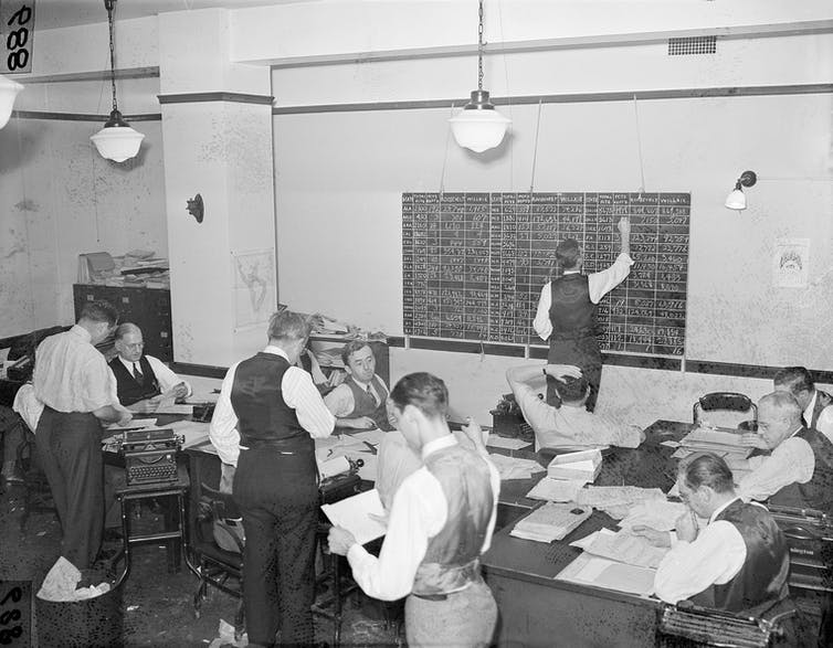 An office filled with employees of the Associated Press tabulating election returns in 1940.
