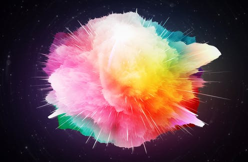 Multicoloured explosion on a dark space backdrop.