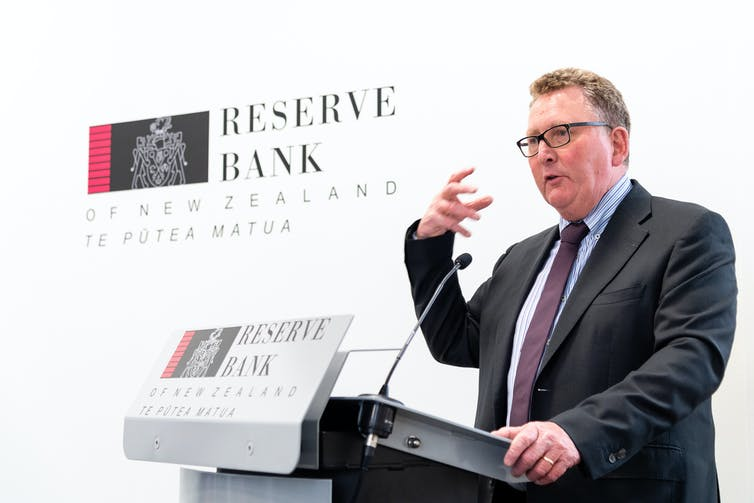 Reserve Bank of NZ governor Adrian Orr speaking at a lecturn