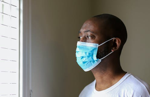 A Black man wearing a face mask.