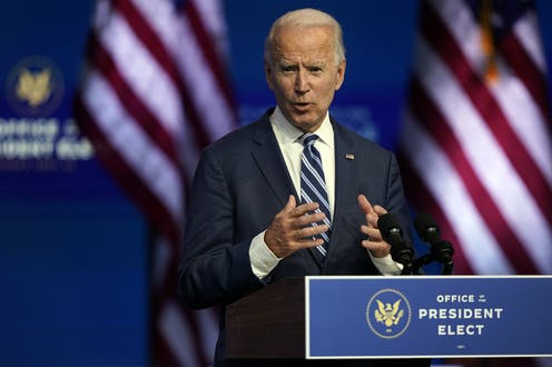 Biden speaks in front of a podium that reads Office of the President-elect