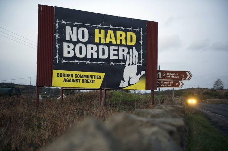 A poster reading 'No hard border' on a road in Northern Ireland.