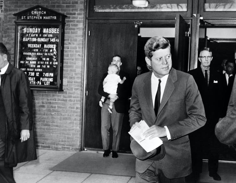 US President John Fitzgerald Kennedy leaves the Saint Stephen Martyr catholic church after attending mass, on October 28, 1962 in Washington DC.