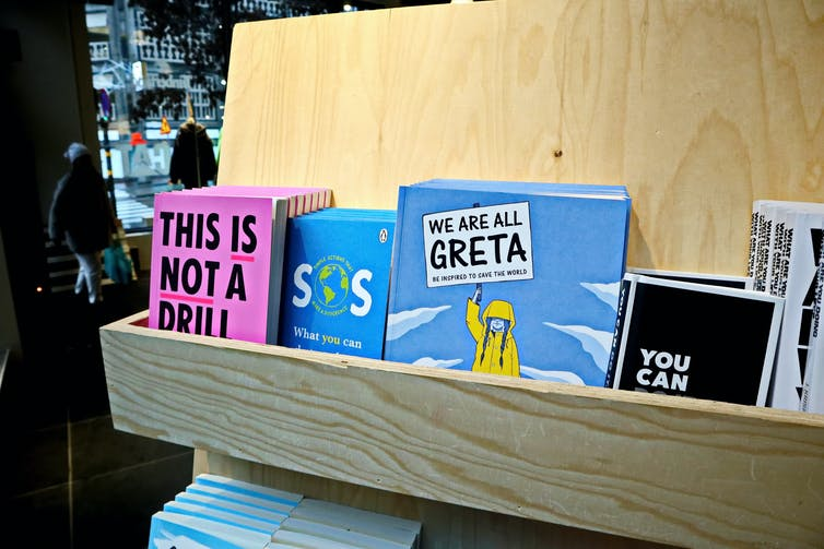 Kids climate books on shelf.