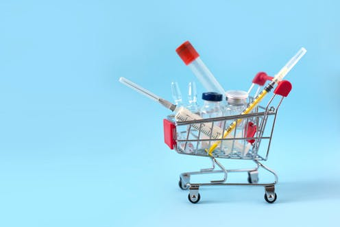 Illustration of vaccines, vials in mini-shopping trolley