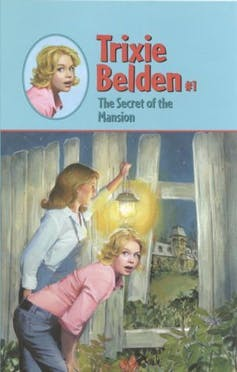 Trixie Belden book cover. Two girls peek through curtain.