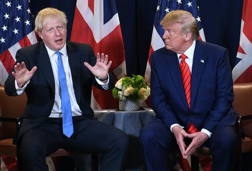 Boris Johnson and Donald Trump in front of their national flags.
