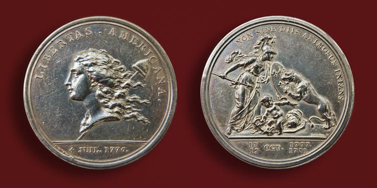 Silver coin depicting liberty as a woman.