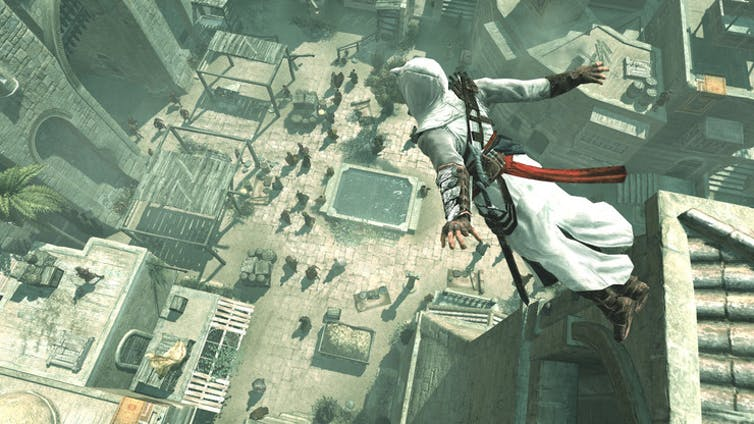 Medieval assassin jumping off a building with a marketplace below.