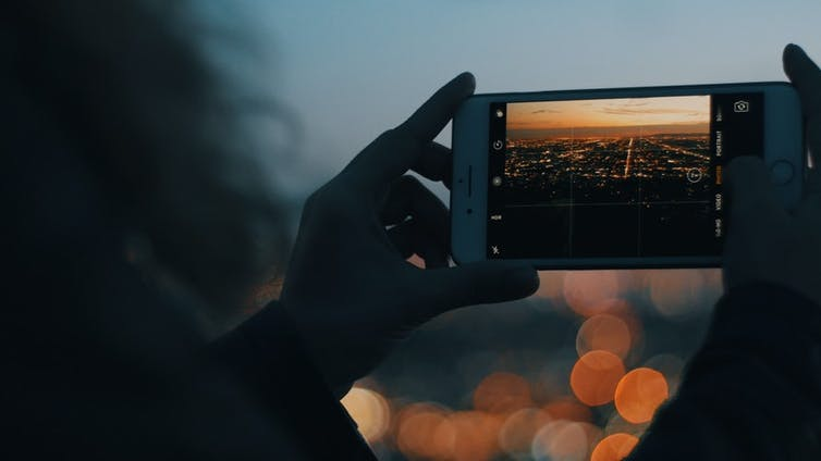 The Los Angeles skyline seen on a smartphone.