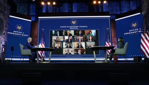 Biden and Harris in front of large virtual meeting screen