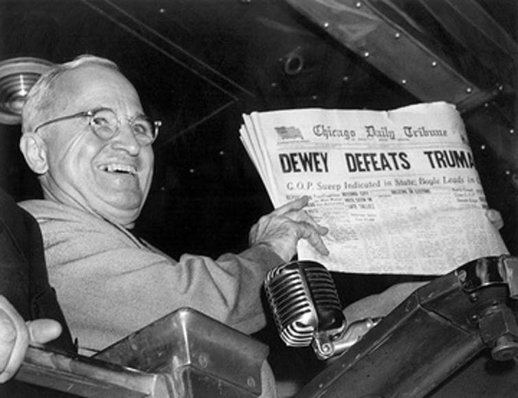 Harry S Truman holding a copy of the Chicago Daily Tribune wrongly calling the election for his rival Thomas E Dewey