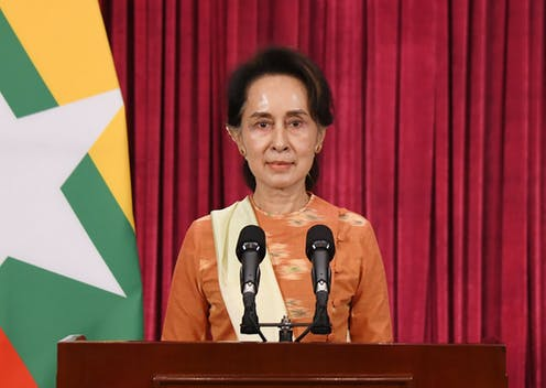 Myanmar leader Aung San Suu Kyi making a speech at a podium.