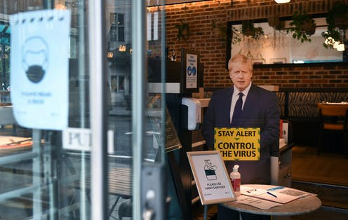 A cardboard cut out of Boris Johnson in a cafe.