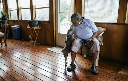 A woman and her pet dog at home.