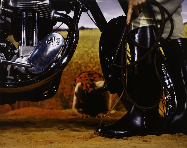 Close up photo: a motorbike and a boot