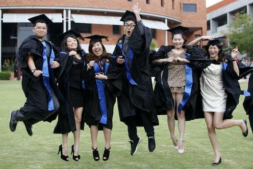 Chinese students celebrate graduation from university