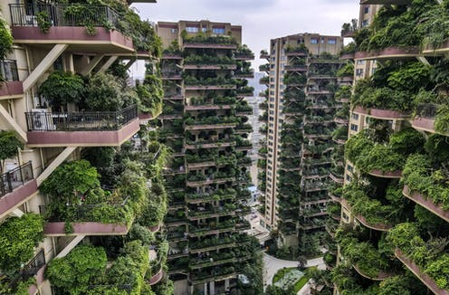 Overgrown vegetation on the balconies of apartments at the Qiyi City Forest Garden residential buildings complex in Chengdu, China.