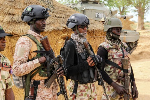 Nigerian Army soldiers stand at a base in Baga, Borno State on August 2, 2019