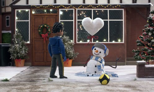 Stop animation of a boy and a snowman with a heart shaped balloon.