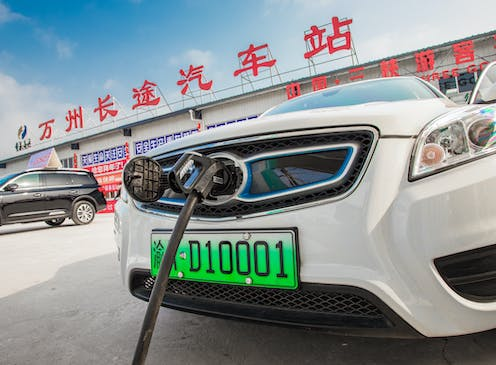 An electric car is charged in Chongqing, China, July 2018
