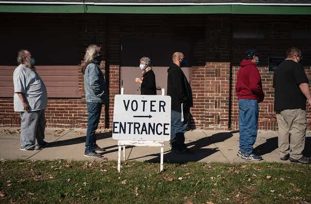 People stand in line to vote